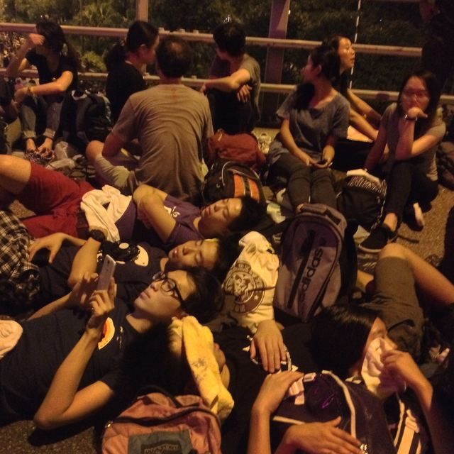 Demonstrators resting on a flyover near Admiralty