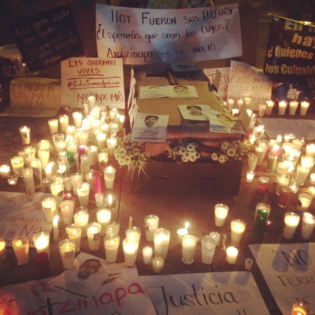 Candles and posters left by protesters as tribute to missing students