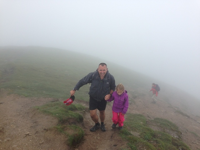 Harriet completing her first Munro is the beautiful Scottish summer...