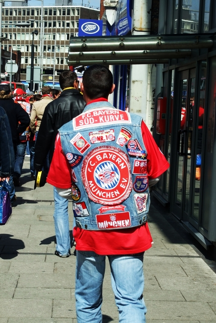 A well travelled Bayern fan makes his way down Wembley High Road