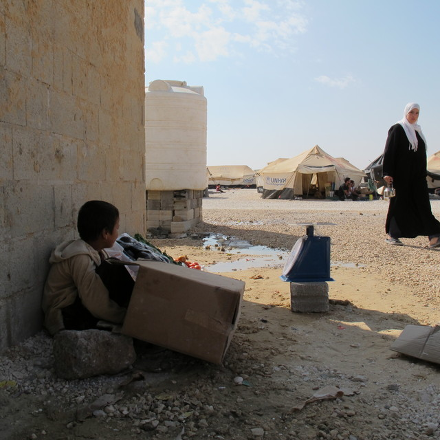 Syrian child selling groceries  at Zaatari camp