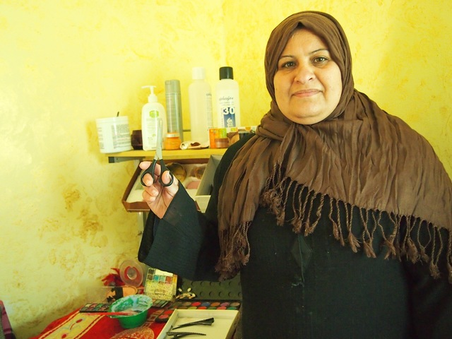 Samar a Syrian refugee from Homs runs a beauty salon from her house