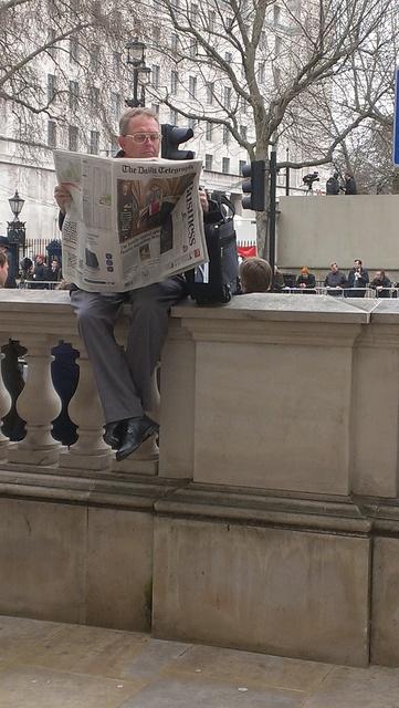 man reads paper