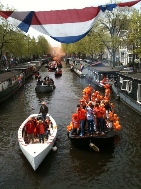 Boats celebrating on Keizersgracht for Queens Day