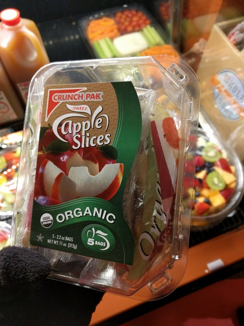 Sliced apples in plastic bags in a plastic box