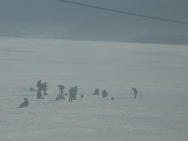 Ice fishing on Lake Baikal