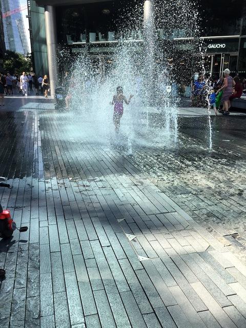 Little girl enjoys the hot weather